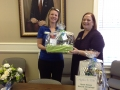 CPA Kim Fourman presents a door prize.